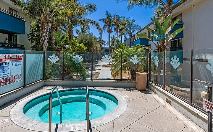 Hot tub outdoors surrounded by glass walls at Westside Terrace, apartments in West Los Angeles