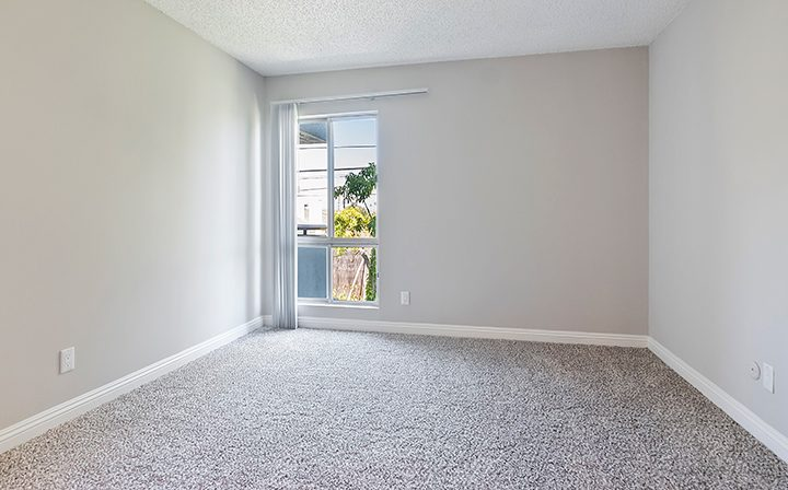 Sunny, unfurnished bedroom with carpet at Westside Terrace, apartments in West Los Angeles