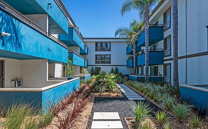 Ornately landscaped outdoor path between units at Westside Terrace, apartments in West Los Angeles