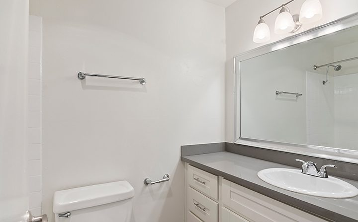 Unfurnished bathroom with vanity lights at Westside Terrace, apartments in West Los Angeles