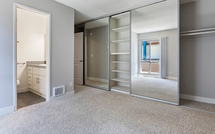 Unfurnished bedroom with mirrored closet doors at Westside Terrace, apartments in West Los Angeles