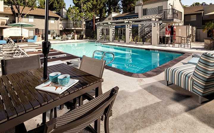 Resort-style pool with brown accents and chairs at Willow Creek, apartments in San Jose