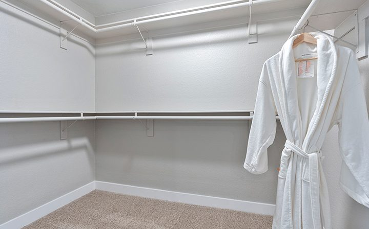 Hanging bathrobe in large carpeted walk-in closet at Willow Creek, apartments in San Jose