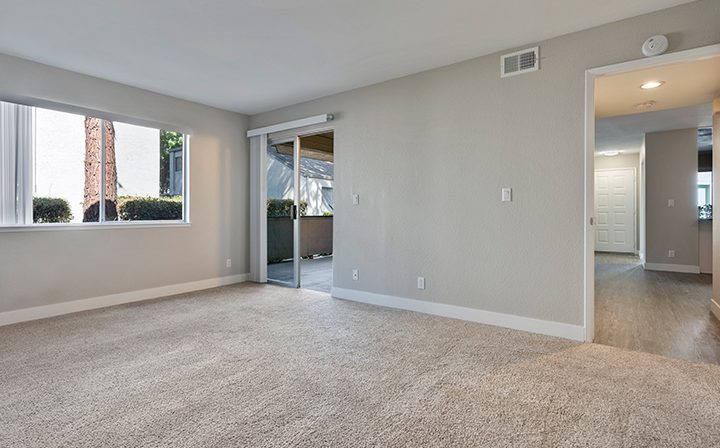 Carpeted, unfurnished room with balcony exit at Willow Creek, San Jose apartments