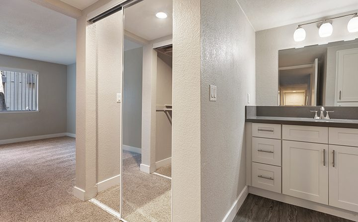 Bathroom next to mirrored closet and bedroom at Willow Creek, apartments in San Jose