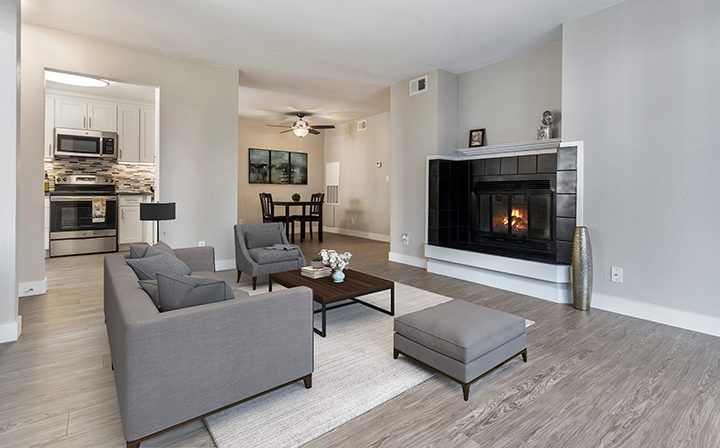 Furnished living room with fireplace in model unit at Willow Creek, apartments in San Jose