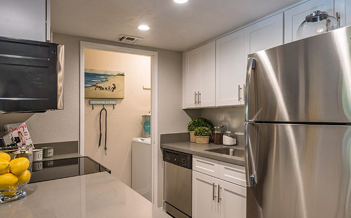 White cabinets in kitchen next to dining room table at Wood Ranch, apartments in Simi Valley