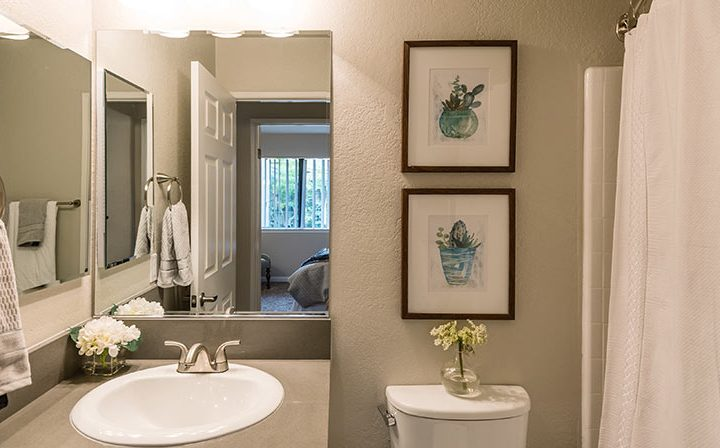 Furnished bathroom with vanity and art at Wood Ranch, Simi Valley apartments