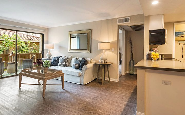 Large furnished living room with light brown wood floor at Wood Ranch, Simi Valley apartments