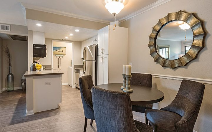 Dining room next to kitchen with overhead light at Wood Ranch, apartments in Simi Valley