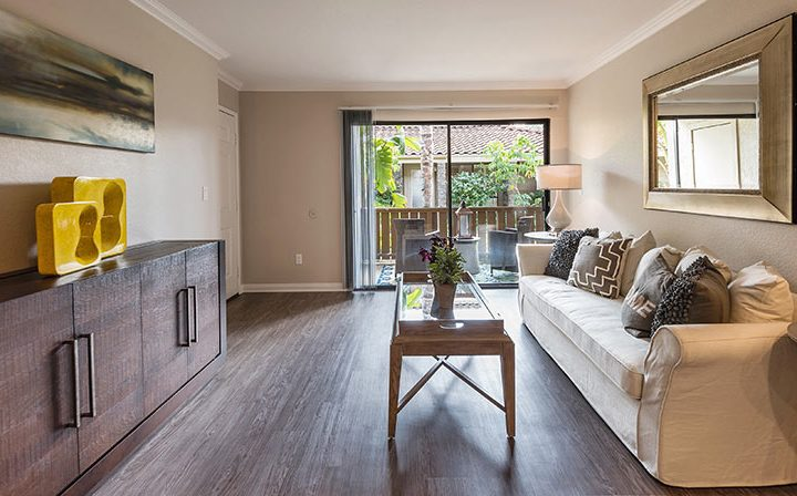 Furnished living room with wood floor and patio exit at Wood Ranch, apartments in Simi Valley