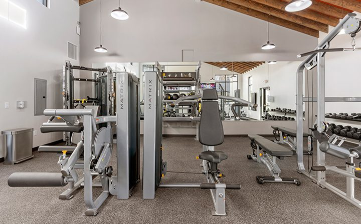 Weights and machines in state-of-the-art fitness center at Wood Ranch, apartments in Simi Valley