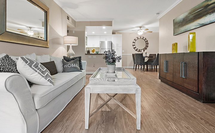 Furnished living room with light brown wood floor at Wood Ranch, Simi Valley apartments
