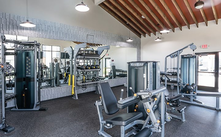 Weight machines in large, sunny fitness room at Wood Ranch, Simi Valley apartments