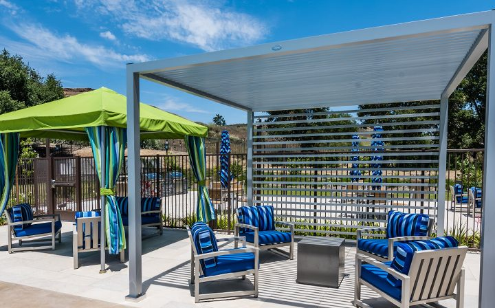 Different types of cabanas over blue chairs on clear day at Wood Ranch, Simi Valley apartments