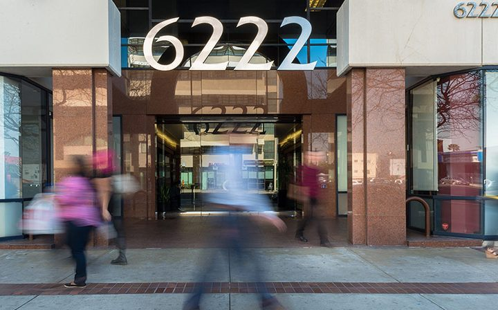 Daytime front entrance of 6222 Wilshire, a Class-A Six-Story Los Angeles office building for rent
