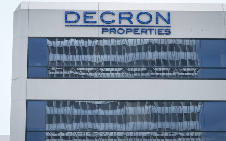 Decron Properties logo on 6222 Wilshire, a Class-A Six-Story Los Angeles office building for rent