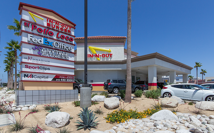 Sign with list of shops next to In-N-Out for The Hub - El Segundo