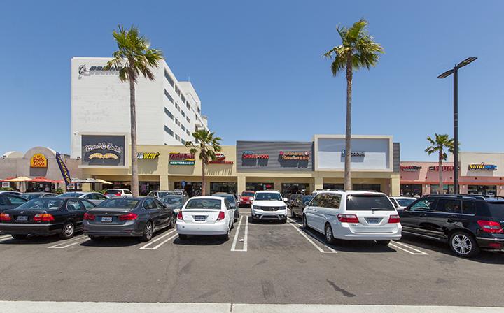 Cars parked outside shops at The Hub - El Segundo