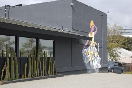 Mural depicting dancing woman at Cincola restaurant near Decron's Playa del Rey apartments