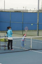 Mother and young daughter playing tennis at court near Decron's Playa del Rey apartments