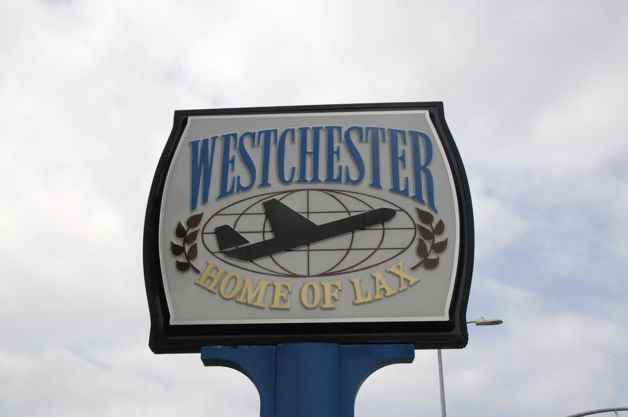 Town sign with airplane near Decron's Playa del Rey apartments, reading: Westchester Home of LAX