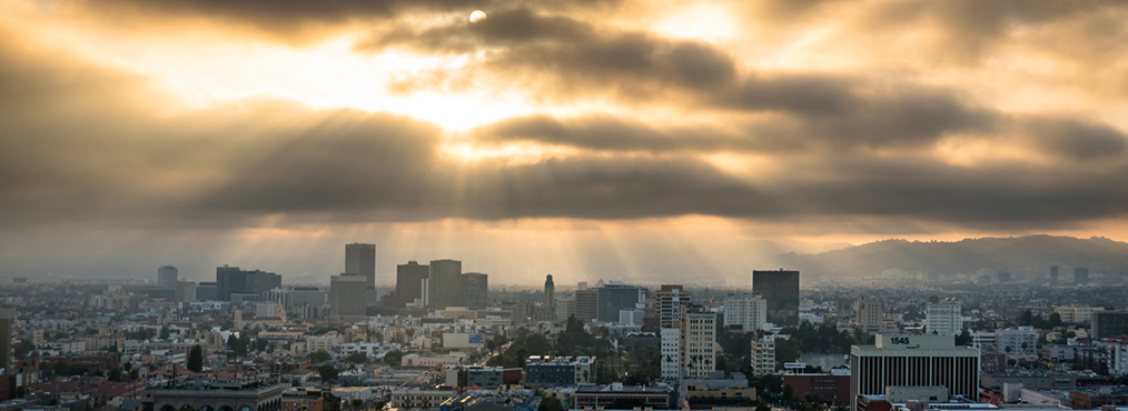 Stunning sunset over the Central Los Angeles skyline, near Decron's Koreatown apartments