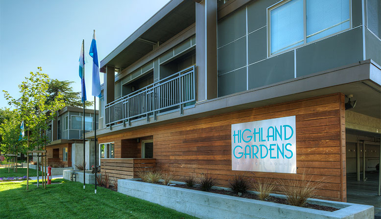 Exterior shot of Decron's Mountain View apartments community Highland Gardens