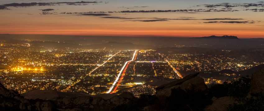 Cliffside twilight view of city lights in the vicinity of Decron's Simi Valley apartments
