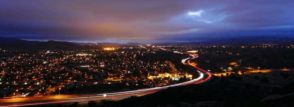 Nighttime city skyline under cloudy sky where you can find Decron's Simi Valley apartments