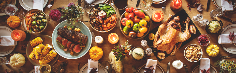 A Thanksgiving dinner served on a long wood table