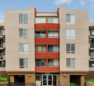 Decron apartment exterior with brown, cream, and burnt sienna color wall accent coloring