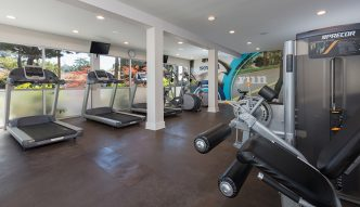 Fitness center at Willow Creek apartments