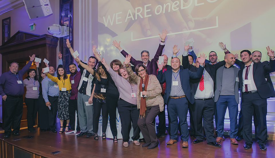 Decron Team on Stage at End of Year Party