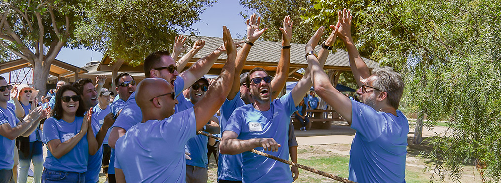 Decron Team Members Celebrating at the 2019 Summer Employee Picnic
