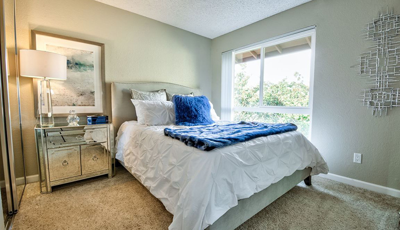 Furnished bedroom interior at Fremont apartment community Rancho Luna Sol