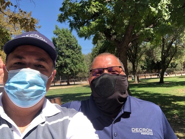 Socially distanced activities with employees wearing masks at the Decron 2020 summer picnic