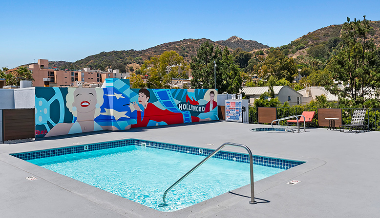 Rooftop pool and mural at The Ruby Hollywood apartments