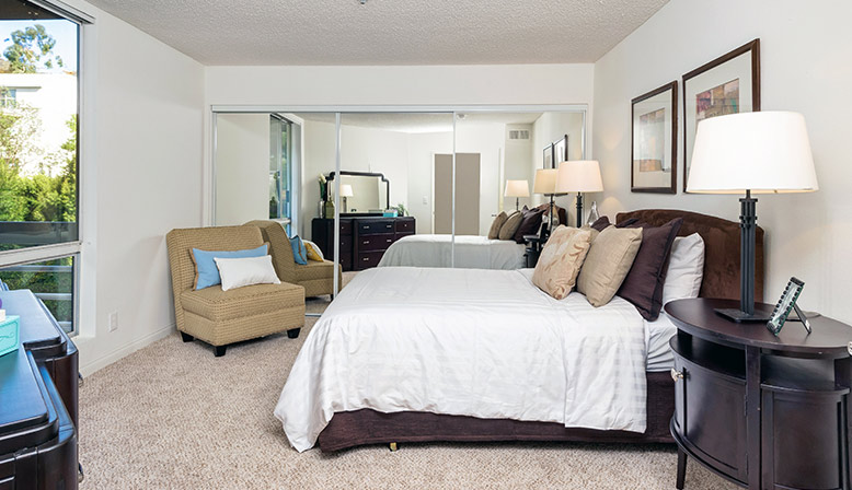 Furnished bedroom interior at The Ruby Hollywood apartments