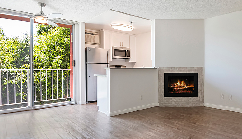 Unfurnished livingroom and patio exist at The Ruby Hollywood apartments