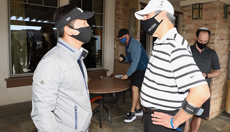 Decron CEO David Nagel chatting with attendee at the 11th Annual Golf Tournament Benefiting YULA