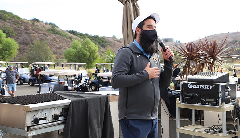 Man giving speech at the 11th Annual Golf Tournament Benefiting YULA