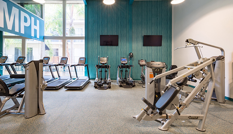 Weight machines in large fitness center at Playa Pacifica, Playa del Rey apartments in Los Angeles
