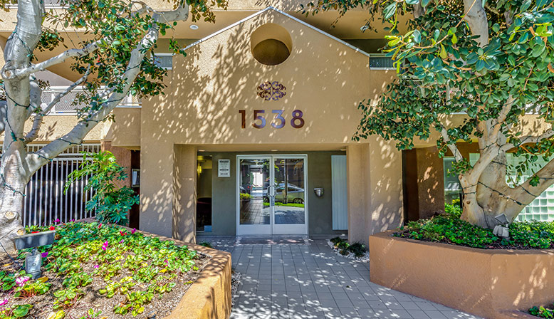 Shaded entrance to building 1538 at Marlon Manor, Los Angeles apartments in Hollywood