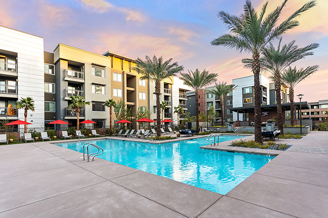 Community pool at sunset at Broadstone Rio Salado, an AZ apartment community acquired by Decron
