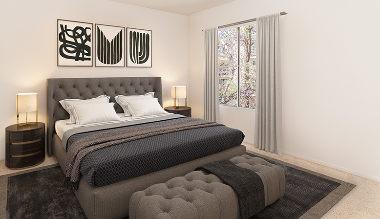 Furnished bedroom in model unit at the Sunset Boulevard apartments community Marlon Manor