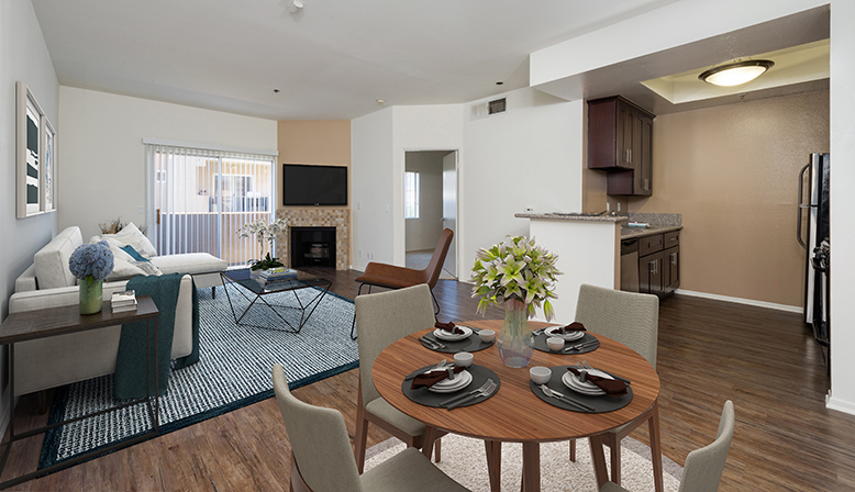 Furnished dining area in model unit at the Sunset Boulevard apartments community The Joshua