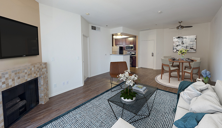 Furnished living room in model unit at the Sunset Boulevard apartments community The Joshua