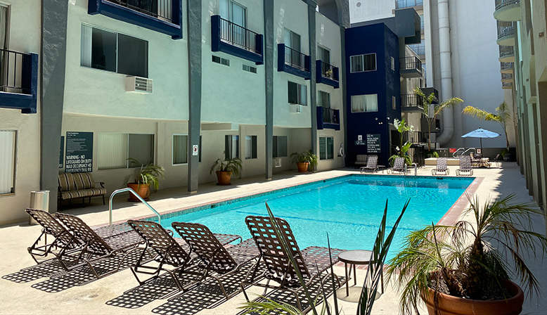 Pool and chairs by the Bay on 6th community, apartments in Santa Monica with blue accents
