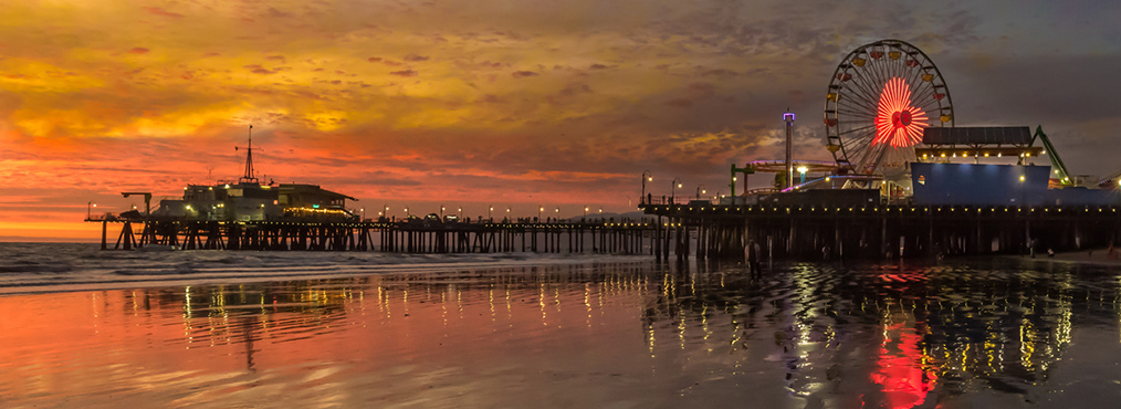 View of the Santa Monica pier at sunset, near Decron's Santa Monica apartments, the Bay on 6th